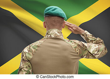 Dark-skinned soldier with flag on background - Jamaica -...
