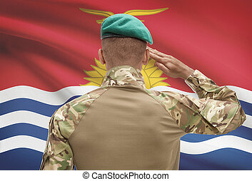 Dark-skinned soldier with flag on background - Kiribati -...