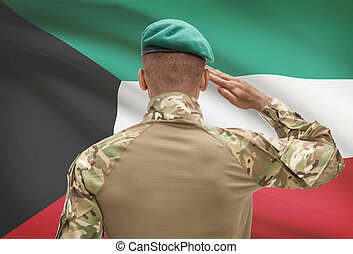 Dark-skinned soldier with flag on background - Kuwait -...