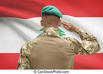 Dark-skinned soldier with flag on background - Lebanon -...