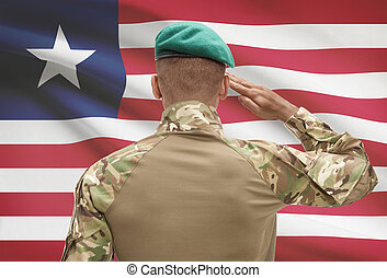 Dark-skinned soldier with flag on background - Liberia -...