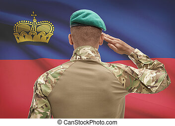 Dark-skinned soldier with flag on background - Liechtenstein...