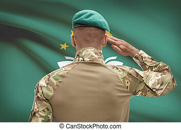Dark-skinned soldier with flag on background - Macau -...