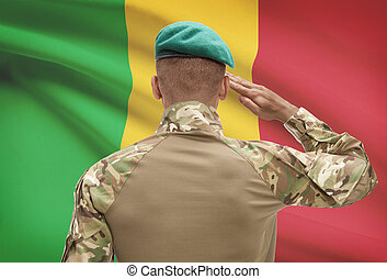 Dark-skinned soldier with flag on background - Mali -...