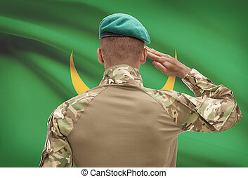 Dark-skinned soldier with flag on background - Mauritania -...