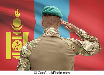 Dark-skinned soldier with flag on background - Mongolia -...