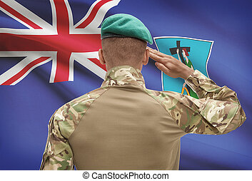 Dark-skinned soldier with flag on background - Montserrat -...