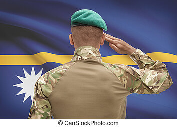 Dark-skinned soldier with flag on background - Nauru -...
