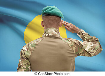 Dark-skinned soldier with flag on background - Palau -...