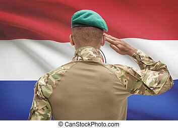 Dark-skinned soldier with flag on background - Paraguay -...