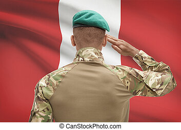 Dark-skinned soldier with flag on background - Peru -...