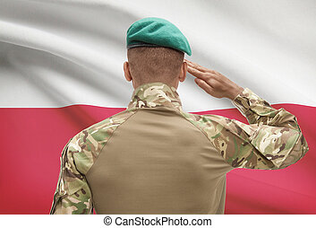 Dark-skinned soldier with flag on background - Poland -...