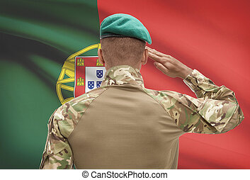 Dark-skinned soldier with flag on background - Portugal -...