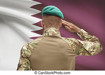 Dark-skinned soldier with flag on background - Qatar -...