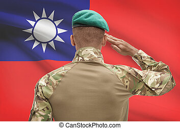 Dark-skinned soldier with flag on background - Taiwan -...