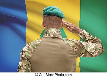 Dark-skinned soldier with flag on background - Saint Vincent...