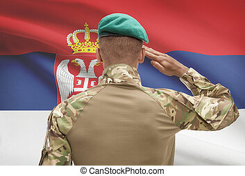 Dark-skinned soldier with flag on background - Serbia -...