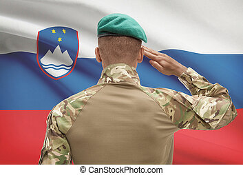 Dark-skinned soldier with flag on background - Slovenia -...