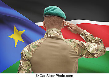 Dark-skinned soldier with flag on background - South Sudan -...