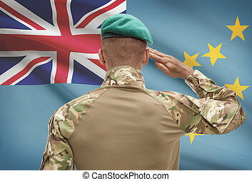 Dark-skinned soldier with flag on background - Tuvalu -...