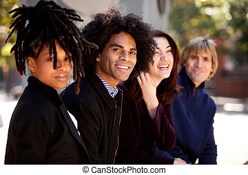 Diverse Group of Four Friends Relaxing Together - Group of...
