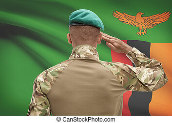Dark-skinned soldier with flag on background - Zambia -...