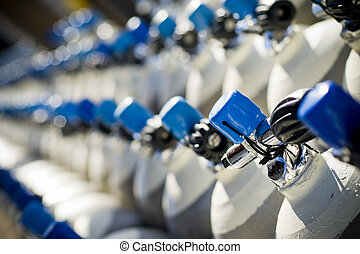 SCUBA Tanks - Many rows of SCUBA diving tanks with blue tank...