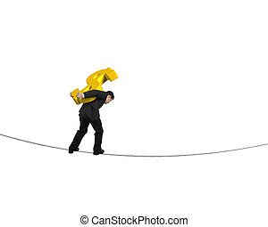 Businessman carrying golden dollar sign balancing on...