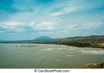 Beautiful sea with waves and mountains.Aerial view.Mui Ne,...