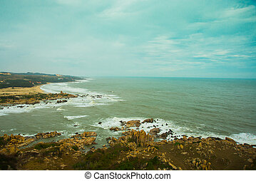 Beautiful sea with waves and mountainsAerial viewMui Ne,...