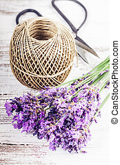 Fresh lavender on the white shabby wooden table with rope...
