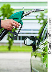 Man fills up his car with a gasoline