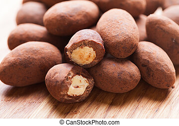 Chocolate truffles with nuts, close up as a background