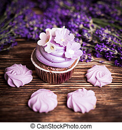 Lavender cakes - cupcake and lilac meringue on a wooden...
