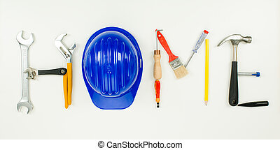 home repair - home word written with construction tools on...