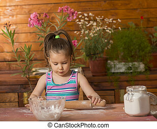 Beautiful little girl cooking - Happy little chef smeary...