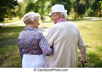 Walking together - Rear view of senior couple taking a walk