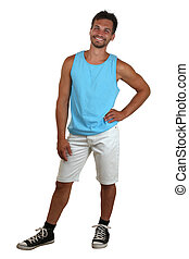 Whole body portrait of a young smiling man in muscle shirt