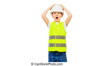 labor rools - Cute boy in a costume of a builder posing with...