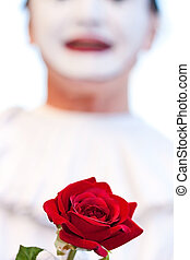 Red rose at street festival in Venice, Italy