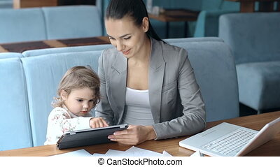 Little User - Close up of young mother teaching her baby...