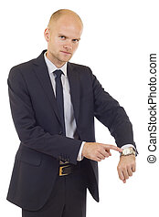 businessman checking time - handsome businessman showing...