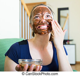woman  putting cosmetic on face