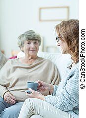 Elderly woman during conversation
