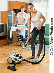 Family cleaning home with vacuum cleaner - Happy family...