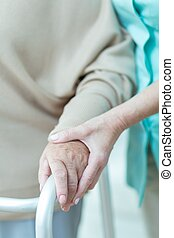 Medic holding patients hand - Close up of medic holding aged...