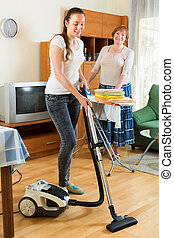 Young girl with vacuum cleaner do housework - Young girl...