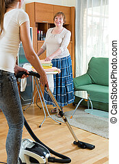 ?leaning the house - Daughter with senior mother doing...