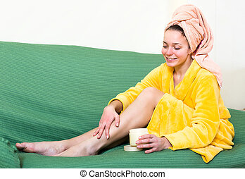 Woman caring for skin on legs