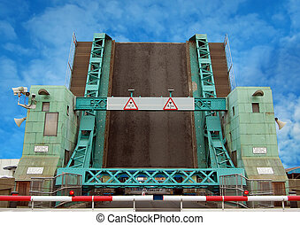 Lifting bridge - A road lifting bridge over a river